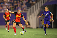 Orlando, Florida - Sunday, May 14, 2016: Western New York Flash defender Jaelene Hinkle (15) plays the ball up field while chased by Orlando Pride defender Kristen Edmonds (12) during a National Women's Soccer League match between Orlando Pride and New York Flash at Camping World Stadium.