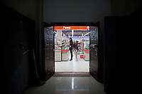 Daytime landscape view of A Woman Standing In A Retail Store in Chongqing, China.  © LAN