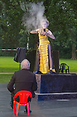 "11 July 2014, Muelheim/Ruhr, Germany. Volker Roos as Creon/Kreon and Simone Thoma as Antigone. Roberto Ciulli's ""Theater an der Ruhr"" perform ""Antigone"" as part of their open-air season ""Weisse Naechte"" (White Nights) in Raffelbergpark, Muelheim an der Ruhr, Germany."