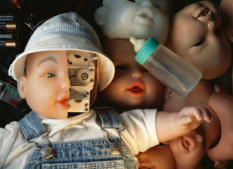 """Robot baby doll. Robot baby doll with part of its """"skin"""" removed to show its inner workings. This toy, known as BIT (Baby IT), is a prototype of the My Real Baby interactive baby doll developed by IRobot Corporation and Hasbro Corporation. The BIT doll mimics the facial expression of a human baby by changing the contours on its lifelike rubber face. The BIT baby doll was developed by IS Robotics, Somerville, Massachusetts, USA."""