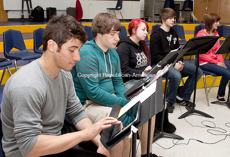 SEYMOUR MAYCT- 02 MAY 2011-050212DA03- Seymour High School students from left, Nick Palmieri, Evan Kravec, Lauren Hall, Amar Lapastica, and Morgan Hicks practice on an unconventional instrument, ipads, during their music theory class on Wednesday. The ipads will be played as part of an original composition that will be performed at the next WSO concert..Darlene Douty Republican American