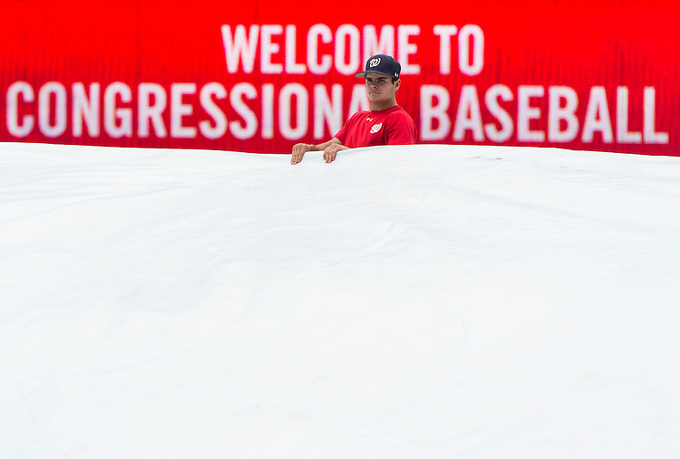 UNITED STATES - JUNE 13: The Nationals ground crew removes the infield tarp in preparation for the 52nd annual Congressional Baseball Game at national Stadium in Washington on Thursday, June 13, 2013. (Photo By Bill Clark/CQ Roll Call)