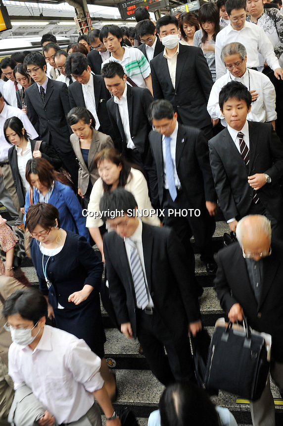 Early morning rush-hour in Shinjuku station, Japan, Friday 5th June. <br /><br />Photo by Richard Jones/Sinopix