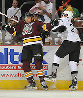 Chicago Wolves' Chris Porter, left, collides with San Antonio Rampage's Mike Mottau during the first period of an AHL hockey game, Friday, Oct. 4, 2013, in San Antonio. Chicago won 2-1. (Darren Abate/M3D14.com)