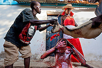 Witchdoctor Rosa Paizone (45), treats her patient, who has mental health problems, by bathing him in goat's blood.