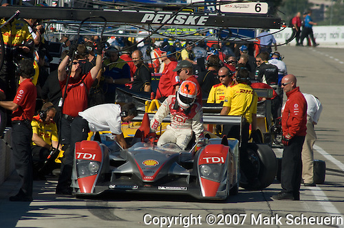 31 August 2007: Emanuelle Pirro (ITA) climbs out of the Audi Sport North America R10 TDI at the Detroit Sports Car Challenge presented by Bosch, Detroit, MI