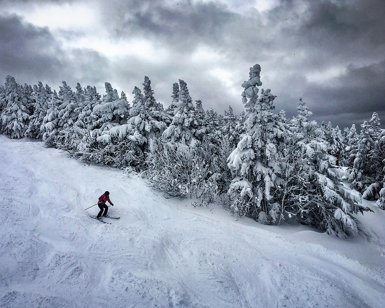 A skier traverses a trail at Stratton Mountain in Vermont on Saturday, March 10, 2018. Photo by Christopher Evans