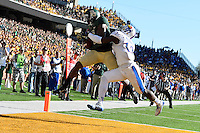 Kansas safety Cassius Sendish (33) breaks a pass intended for Baylor wide receiver Antwan Goodley (5) during NCAA football game, Saturday, November 01, 2014 in Waco, Tex. (Mo Khursheed/TFV Media via AP Images)