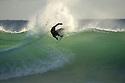 Brazilian surfer at Gas Bay near Margaret River in Western Australia.