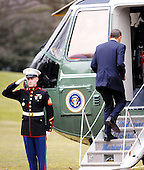 The Marine Guard salutes United States President Barack Obama as he boards Marine 1 to depart the White House en route to Savannah, Georgia, Tuesday,  March 2, 2010 in Washington DC..Credit: Olivier Douliery / Pool via CNP