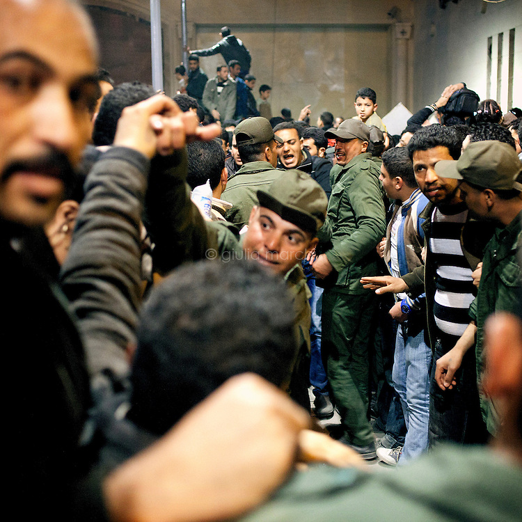Egypt / Cairo / 18.3.2012 / The army is trying to build a passage for the people as women and children suffering because of the crowd: thousands of grieving Copts flocked to St Mark's Coptic Cathedral in Abbasseya on March 18th, for visiting Pope Shenouda III, the spiritual leader of the Middle East's largest Christian minority, died the 17th of March. Three persons have been crushed to death and 137 injured near the St Mark's Coptic Cathedral the evening of the 18th, first day of exhibition of the body of the Pope. Pope Shenuda III died at the age of 88, after a long battle with illness and based on his wishes he had been buried on March 20, at St. Bishoy monastery in Wadi Natrun in the Nile Delta where he spent his time in exile after a dispute with late president Anwar Sadat. Cairo, Egypt. March 18th, 2012.