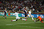 12 JUN 2010:  Emile Heskey (ENG)(21) shoots on goal as Tim Howard (USA)(right) blocks the shot as Wayne Rooney (ENG)(10), Oguchi Onyewu (USA)(5), and Steve Cherundolo (USA)(6) follow the play.  The England National Team and the United States National Team were tied 1-1 after the first half at Royal Bafokeng Stadium in Rustenburg, South Africa in a 2010 FIFA World Cup Group C match.