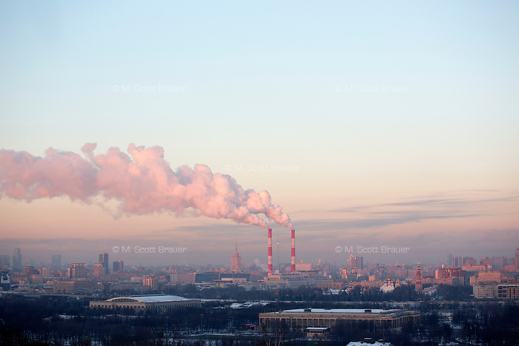 Smokestacks stand above Moscow as viewed from Smotrovaya Ploshadka (Viewing Square) in the Vorobyevy Gory (Sparrow Hills) near Moscow State University in Moscow, Russia.