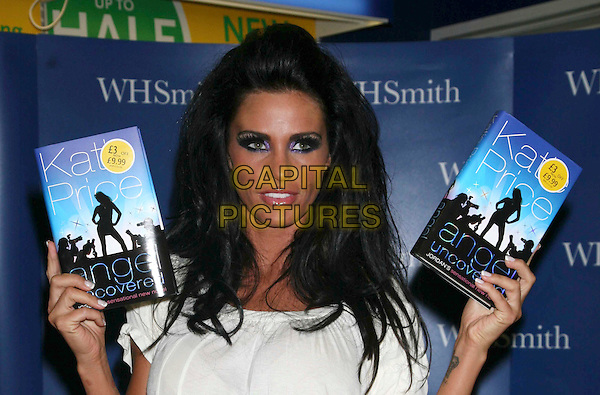 "KATIE PRICE aka JORDAN.At a book signing for her new novel ""Angel Uncovered"" at WH Smith, Bentall Centre, Kingston Upon Thames, London, England, July 19th 2008..portrait headshot purple eyeshadow make-up black hair holding books.CAP/DS.©Dudley Smith/Capital Pictures"