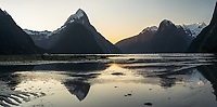 Reflections of Mitre Peak in Milford Sound at sunset, Fiordland National Park, UNESCO World Heritage Area, Southland, New Zealand, NZ