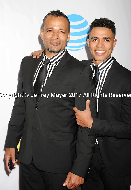 PASADENA, CA - FEBRUARY 11: Actor Mario Van Peebles (L) and Mandela Van Peebles arrive at the 48th NAACP Image Awards at Pasadena Civic Auditorium on February 11, 2017 in Pasadena, California.