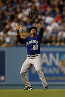 Jonathan Herrera #18 of the Colorado Rockies during a game against the Los Angeles Dodgers at Dodger Stadium on April 30, 2013 in Los Angeles, California. (Larry Goren/Four Seam Images)