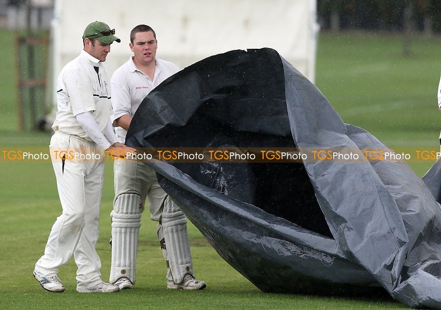 A not unusual scene as the covers come on at Upminster CC as rain interrupts play - Upminster CC vs Saffron Walden CC - Essex Cricket League - 06/09/08 - MANDATORY CREDIT: Gavin Ellis/TGSPHOTO - Self billing applies where appropriate - 0845 094 6026 - contact@tgsphoto.co.uk - NO UNPAID USE.