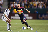 New York Red Bulls midfielder Joel Lindpere (20) attempts to move around LA Galaxy defender Sean Franklin (5). The LA Galaxy and Red Bulls of New York played to a 1-1 tie at Home Depot Center stadium in Carson, California on  May 7, 2011....