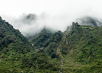 Clouds swirling through side valleys and rainforest in Fox Glacier valley, Westland Tai Poutini National Park, West Coast, UNESCO World Heritage Area, New Zealand, NZ