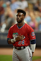 "Fort Myers Miracle Akil Baddoo (24) during ""God Bless America"" in the seventh inning stretch of a Florida State League game against the Charlotte Stone Crabs on April 6, 2019 at Charlotte Sports Park in Port Charlotte, Florida.  Fort Myers defeated Charlotte 7-4.  (Mike Janes/Four Seam Images)"