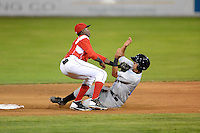 Batavia Muckdogs shortstop Javier Lopez (35) tags out Omar Narvaez attempting to steal during a game against the Hudson Valley Renegades on August 6, 2013 at Dwyer Stadium in Batavia, New York.  Batavia defeated Hudson Valley 4-3.  (Mike Janes/Four Seam Images)