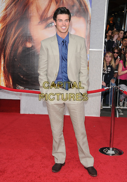 "VANESSA WILLIAMS.""The Hannah Montana Movie"" Los Angeles Premiere held at the El Capitan Theatre, Hollywood, California, USA. .April 2nd, 2009.full length beige suit blue pinstripe shirt tie hand in pockets .CAP/DVS.©Debbie VanStory/Capital Pictures."