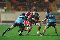 Will Boyde of Scarlets is tackled by George Earle of Cardiff Blues during the Guinness Pro14 match between the Scarlets and Cardiff Blues at Parc Y Scarlets, Llanelli, Wales, UK. Saturday 22 December 2018