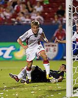 New England Revolution forward Taylor Twellman (20) scores on FC Dallas goalkeeper Dario Sala (48).  New England Revolution defeated FC Dallas 3-2 to capture the 2007 Lamar Hunt U.S. Open Cup at Pizza Hut Park in Frisco, TX on October 3, 2007.