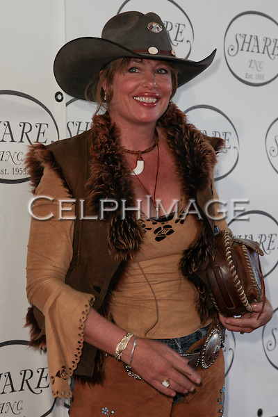 "KELLY LEBROCK. Red Carpet arrivals to the 57th Annual Boomtown Event, sponsored by SHARE (Share Happily And Reap Endlessly), honoring actress Jamie Lee Curtis with the ""Shining Spirit Award."" Santa Monica, CA, USA. June 5, 2010."