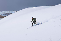 A backcountry skier descends a dune in the Grand Sable Dunes in Pictured Rocks National Lakeshore near Grand Marais, Michigan.