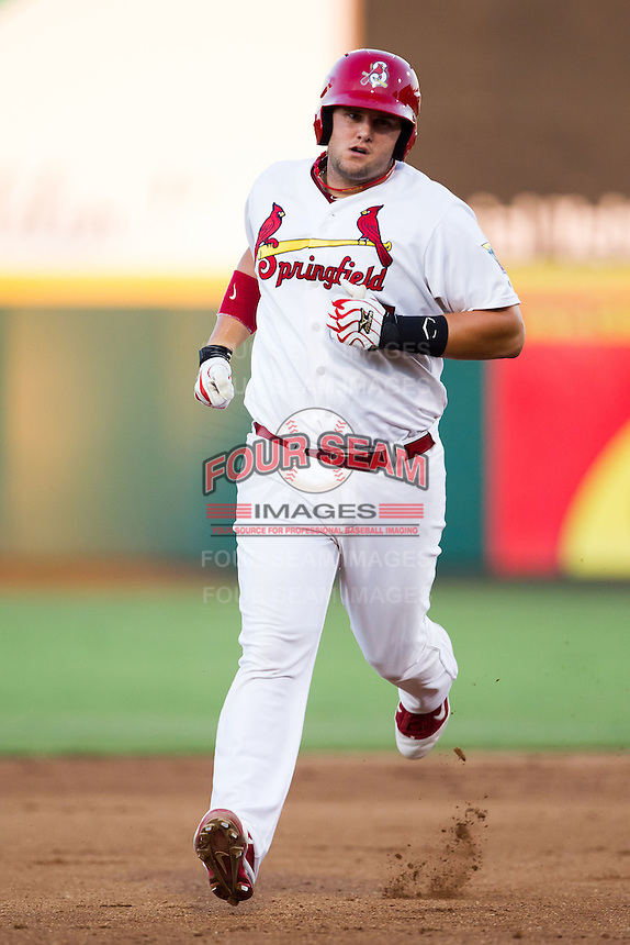 Matt Adams (25) of the Springfield Cardinals rounds the bases after hitting a home run during a game against the Tulsa Drillers at Hammons Field on July 18, 2011 in Springfield, Missouri. Tulsa defeated Springfield 13-8. (David Welker / Four Seam Images)