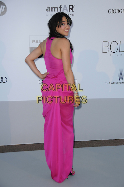 MICHELLE RODRIGUEZ.arrivals at amfAR's Cinema Against AIDS 2010 benefit gala at the Hotel du Cap, Antibes, Cannes, France during the Cannes Film Festival.20th May 2010.amfAR full length bright pink long maxi dress hand on hip back rear behind .CAP/CAS.©Bob Cass/Capital Pictures.