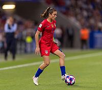 LYON,  - JULY 2: Kelley O'Hara #5 dribbles during a game between England and USWNT at Stade de Lyon on July 2, 2019 in Lyon, France.