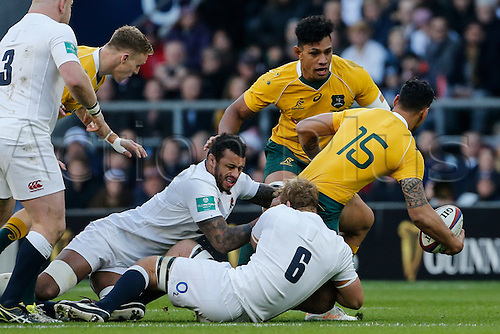 03.12.2016. Twickenham, London, England. Autumn International Rugby. England versus Australia.  Israel Folau of Australia is tackled by Chris Robshaw and Courtney Lawes of England.   Final score: England 37-21 Australia.