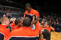 Dec. 22, 2010; Charlottesville, VA, USA; Virginia Cavaliers guard K.T. Harrell (24) is boosted by his teammates before the start of the game against the Seattle Redhawks at the John Paul Jones Arena. Mandatory Credit: Andrew Shurtleff
