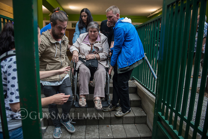 Catalan independence vote in Barcelona. The election goes ahead at a polling staion at the 'Ecole Barcelona' School despite the election being declared illegal by the government. 1-10-17 A disabled voter is assisted by volunteers.