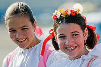 Young Czech girls, wearing folk costume, wait for the arrival of the Pope Benedict XVI at the Prague Airport, Czech Republic, 26 September 2009.