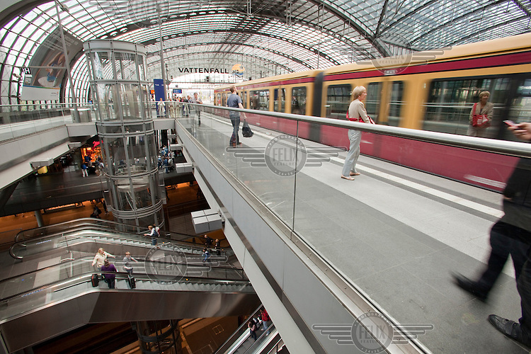 "Berlin's new main train and subway station, Hauptbanhof. It is Europe's largest ""crossing"" station with above ground lines running east-west and underground lines running north-south.."