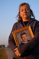 Pam Skaanning, a spokeswoman for Mothers Against Drunk Driving, stands on the shoulder of County Highway N in Sun Prairie, WI, where her son Jason was killed by a drunk driver while delivering newspapers on August 27, 2000. <br /> <br /> Client: Walgreens<br /> &copy; Michael Forster Rothbart<br /> www.mfrphoto.com <br /> 607-267-4893 o 607-432-5984<br /> 5 Draper St, Oneonta, NY 13820<br /> 86 Three Mile Pond Rd, Vassalboro, ME 04989<br /> info@mfrphoto.com<br /> Photo by: Michael Forster Rothbart<br /> Date: 11/04    File#:  Canon 5D digital camera frame 10059<br /> --------------<br /> Original caption:<br /> <br /> Pam Skaanning, a spokeswoman for Mothers Against Drunk Driving, stands on the shoulder of County Highway N in Sun Prairie, WI, where her son Jason was killed by a drunk driver while delivering newspapers on August 27, 2000. This portrait was shot for a cover story in the Walgreens publication Applause, Jan-Feb 2005 issue.