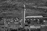 Seen from the water tower in Matan, a mosque minaret stands above Hableh.