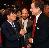Actor Michael J. Fox, left, is greeted by United States Senator Arlen Spector (Republican of Pennsylvania), right,  Chairman of the U.S. Senate Appropriations Subcommittee on Labor, Health and Human Services, and Education on September 28, 1999.   Fox, who suffers from Parkinson's Disease, testified on the need for funding further research and treatment of the disease. U.S. Senator Paul Wellstone (Democrat of Minnesota), center, looks on..Credit: Ron Sachs / CNP