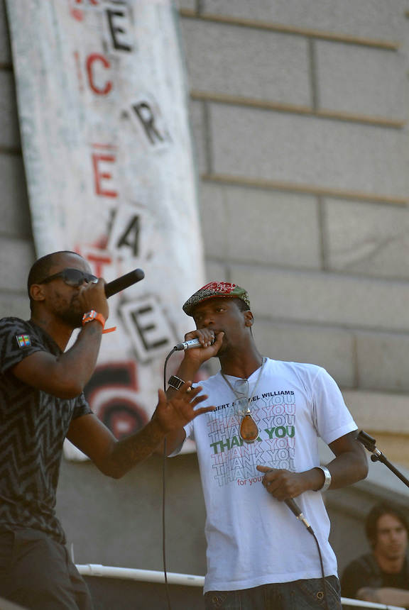 24 Aug 08: Stic.man (left) and M-1 of the hip hop duo Dead Prez perform on the steps of the Colorado state capitol building. On the day before the Democratic National Convention is scheduled to begin about 1,500 people participated in the ReCreate 68 rally, which included a march from the Colorado state capitol building to the Pepsi Center.