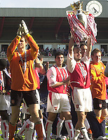 Premiership Football - Arsenal v Leicester City:.2003/04 Season - 15/05/2004  [Record breaking Season undefeated] .Fredrik Ljungberg, shows the Cup to the supporters, left Keeper Jens Lehmann applauds the crowd.[Credit] Peter Spurrier Intersport Images