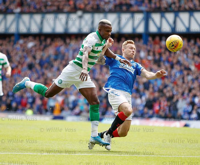 01.09.2019 Rangers v Celtic: Scott Arfield bundled over by Boli Bolingoli