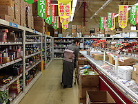 An older woman in a kimono shopping in a supermarket near Machida, Tokyo, Japan Monday January 4th 2016