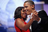 United States President Barack Obama and first lady Michelle Obama sing together as they dance during the Inaugural Ball at the Walter Washington Convention Center January 21, 2013 in Washington, DC. President Obama started his second term by taking the Oath of Office earlier in the day during a ceremony on the West Front of the U.S. Capitol. .Credit: Chip Somodevilla / Pool via CNP
