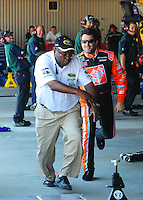 May 30, 2008; Dover, DE, USA; Nascar Sprint Cup Series driver Tony Stewart playfully chases a NASCAR official during practice for the Best Buy 400 at the Dover International Speedway. Mandatory Credit: Mark J. Rebilas-US PRESSWIRE