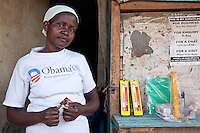 """Since 2006, Evalin Aoko, 38, has been selling children candies and stationery from her verandah stand close to one of the largest secondary schools in Nairobi's Kibera slum. """"I am aiming that one day I will be out from where I am now, somewhere better."""""""