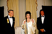 Jackie Stallone, center, mother of American actor, director, screenwriter, and producer Sylvester Stallone, right, makes remarks as her son is honored by the Washington, DC Touchdown Club in Washington, DC on January 23, 1988.  At left is former Washington Redskins head coach George Allen.<br /> Credit: Arnie Sachs / CNP